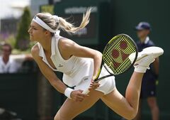Russia's Maria Kirilenko plays a return to Sloane Stephens of the U.S. during their first round match at the All England Lawn Tennis Championships in Wimbledon, London, Monday, June 23, 2014. (AP Photo/Pavel Golovkin)