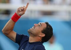FILE - In this Oct. 22, 2011 file photo, Dominican Republic's Victor Estrella celebrates winning the bronze medal forring the tennis men's singles final event against Ecuador's Julio Cesar Campuzano at the Pan American Games in Guadalajara, Mexico. Estrella, 34, will play at the U.S. Open which begins on Monday, Aug. 25, 2014. (AP Photo/Silvia Izquierdo, File)