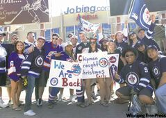 Winnipeg Jets fans gather outside the Jobing.com Arena in Glendale, Ariz., Saturday before the NHL game between the Winnipeg Jets and the Phoenix Coyotes.