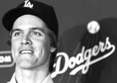 Zack Greinke is a happy man as his $147-million, six-year contract to pitch for the Dodgers is announced on Tuesday.