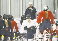 St. Mary's Flames coach Larry Bumstead instructs his players.