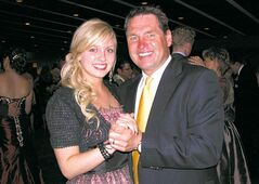 Hockey commentator Kelly Hrudey and his daughter, Kaitlin, dance at her Grade 12 graduation in 2011.