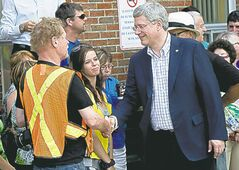 Prime Minister Stephen Harper visits the emergency centre in Lac-Mégantic, Que.