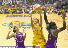 Los Angeles Sparks guard Kristi Toliver, center, puts up a shot as Phoenix Mercury guard Briana Gilbreath, left, and forward Lynetta Kizer defend during the second half in Game 3 of a WNBA basketball Western Conference semifinal series, Monday, Sept. 23, 2013, in  Los Angeles. The Mercury won 78-77. (AP Photo/Mark J. Terrill)