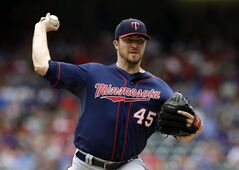 Minnesota Twins starting pitcher Phil Hughes works against the Texas Rangers in the first inning of a baseball game, Saturday, June 28, 2014, in Arlington, Texas. (AP Photo/Tony Gutierrez)