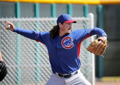 Chicago Cubs pitcher Jeff Samardzija throws during the team's first spring training baseball practice, Friday, Feb. 14, 2014, in Mesa, Ariz. (AP Photo/Matt York)