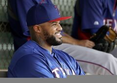 Texas Rangers' Prince Fielder smiles as he talks with teammates in the dugout before a morning workout during spring training baseball practice, Wednesday, Feb. 19, 2014, in Surprise, Ariz. (AP Photo/Tony Gutierrez)