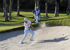 John Senden, of Australia, hits from the bunker to the ninth green during the second round of the Northern Trust Open golf tournament at Riviera Country Club in the Pacific Palisades area of Los Angeles on Friday, Feb. 14, 2014. (AP Photo/Reed Saxon)