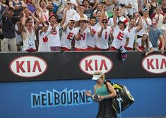 Supporters of Eugenie Bouchard cheer as she walks off the court in Melbourne, Australia, on Jan. 15, 2014. Founding members of the Genie Army, a group of Eugenie Bouchard supporters who cheered for the rising tennis star during the Australian Open in January, will be in the Montreal for the Rogers Cup, beginning this weekend. THE CANADIAN PRESS/AP, Andrew Brownbill