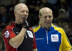 Alberta skip Kevin Martin, right, and Ontario skip Glenn Howard, left, looks at the rings during the Brier Canadian Curling Championships in London, Ont., on Thursday, March 10, 2011. The 2013 Tim Hortons Brier opens Saturday at Rexall Place. Martin's team out of Edmonton's Saville Centre represents the host province. THE CANADIAN PRESS/Nathan Denette