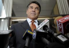 Texas Gov. Rick Perry speaks to the media before hosting a lunch appointment with Connecticut gun makers in Hartford, Conn., Monday, June 17, 2013. The governors of Texas and South Dakota are visiting Connecticut to court local gun makers, many of which have threatened to leave since the state passed tough new gun-control laws in response to the massacre at Sandy Hook Elementary School. (AP Photo/Jessica Hill)