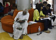 Indians send telegrams on the last day of the 163-year-old service at the central telegraph office in Mumbai, India, Sunday, July 14, 2013. On Sunday night the state-run telecommunications company will send its final telegram, closing down a service that fast became a relic in an age of email, reliable landlines and ubiquitous cellphones. (AP Photo/Rafiq Maqbool)