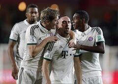 Bayern's Franck Ribery, center, celebrates with teammates after scoring a goal during the semifinal soccer match between Guangzhou Evergrande and Bayern Munich at the Club World Cup soccer tournament in Agadir, Morocco, Tuesday, Dec. 17, 2013. (AP Photo/Christophe Ena)