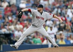 Boston Red Sox starting pitcher Jon Lester works in the first inning of a baseball game against Atlanta Braves on Tuesday, May 27, 2014, in Atlanta. (AP Photo/John Bazemore)