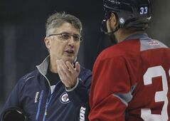 Winnipeg Jets head coach Claude Noel talks to Dustin Byfuglien (33) on day three of training camp in Winnipeg on Tuesday, January 15, 2013. (THE CANADIAN PRESS/John Woods)