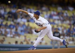 Los Angeles Dodgers starting pitcher Zack Greinke throws to the plate during the first inning of a baseball game against the Atlanta Braves, Wednesday, July 30, 2014, in Los Angeles. (AP Photo/Mark J. Terrill)