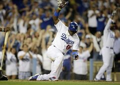 Los Angeles Dodgers' Yasiel Puig celebrates after he scored on a double hit by Hanley Ramirez during the sixth inning of a baseball game against the Miami Marlins on Tuesday, May 13, 2014, in Los Angeles. (AP Photo)
