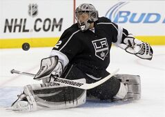 Los Angeles Kings goalie Jonathan Quick blocks a shot by the Minnesota Wild during the first period of an NHL hockey game, Tuesday, Jan. 7, 2014, in Los Angeles. (AP Photo/Alex Gallardo)