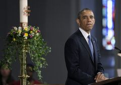 President Barack Obama pauses while speaking at the