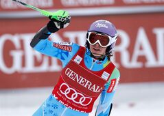 Slovenia's Tina Maze celebrates after winning an alpine ski, women's world cup super-combined, in Meribel, France, Sunday, Feb. 24, 2013. (AP Photo//Marco Trovati)