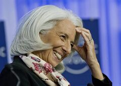 Head of the International Monetary Fund Christine Lagarde, smiles during a session at the World Economic Forum in Davos, Switzerland, Saturday, Jan. 25, 2014. (AP Photo/Michel Euler)