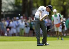 Phil Mickelson hits his approach shot on the ninth hole during the third round of the Wells Fargo Championship golf tournament in Charlotte, N.C., Saturday, May 3, 2014. (AP Photo/Chuck Burton)
