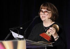 FILE - In a Nov. 9, 2011, file photo Linda Ronstadt accepts the Life Time Achievement award at the Latin Recording Academy Lifetime Achievement Award and Trustees Award ceremony in Las Vegas. In an AARP Magazine article posted online Friday, Aug. 23, 2013, Ronstadt says that she was diagnosed with Parkinson's disease and