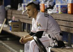 FILE - In this April 29, 2014 file photo, Miami Marlins starting pitcher Jose Fernandez sits in the dugout after pitching eight innings against the Atlanta Braves, in Miami. More than a dozen major league pitchers have needed Tommy John surgery this year, a group that includes All-Stars Patrick Corbin, Josh Johnson and Matt Moore. NL Rookie of the Year Jose Fernandez is among three others headed to elbow ligament-replacement surgery, joining an illustrious group that includes Chris Carpenter (2007), Stephen Strasburg (2010), Adam Wainwright (2011) and Matt Harvey (2013). (AP Photo/File)
