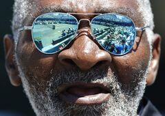 FILE - In this April 7, 2012, file photo, Richard Williams cheers for his daughter, Serena Williams, between points of her semifinal match against Samantha Stosur, of Australia, at the Family Circle Cup tennis tournament in Charleston, S.C. His new book,
