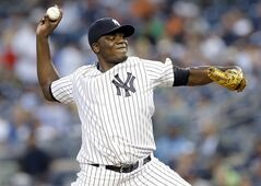 New York Yankees' Michael Pineda delivers a pitch during the first inning of a baseball game against the Houston Astros Wednesday, Aug. 20, 2014, in New York. (AP Photo/Frank Franklin II)