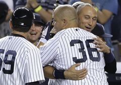 New York Yankees' Carlos Beltran (36) is congratulated by Derek Jeter after hitting the game-winning three-run home run against the Baltimore Orioles in the ninth inning of a baseball game, Friday, June 20, 2014, in New York. The Yankees won 5-3. (AP Photo/Julie Jacobson)