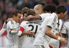 Bayern players celebrate their side's second goal during a f German first division Bundesliga soccer match between 1.FC Nuremberg and Bayern Munich in Nuremberg, Germany, Saturday, Feb. 8, 2014. (AP Photo/Michael Probst)