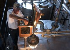 FILE -- In this Sept. 2003 file photo, Gary Hinshaw tests the proof of the whiskey at the George Dickel Distillery near Tullahoma, Tenn. Alcohol regulators ended their investigation Tuesday, June 10, 2014, into whether George Dickel, a subsidiary of liquor giant Diageo, violated state laws by storing whiskey in neighboring Kentucky. (AP Photo/Mark Humphrey, File)