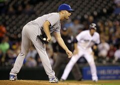 Kansas City Royals starting pitcher Danny Duffy prepares to throw as Seattle Mariners' Michael Saunders, who walked earlier, leads off of first base, in the first inning of a baseball game Thursday, May 8, 2014, in Seattle. (AP Photo/Elaine Thompson)