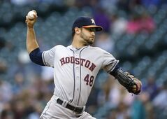 Houston Astros starting pitcher Jarred Cosart throws against the Seattle Mariners on Thursday, May 22, 2014, in the first inning of a baseball game in Seattle. (AP Photo/Ted S. Warren)