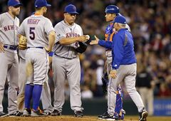 New York Mets starting pitcher Bartolo Colon, third from right, is pulled in the eighth inning by manager Terry Collins, front right, during a baseball game against the Seattle Mariners, Wednesday, July 23, 2014, in Seattle. The Mets won 3-2. (AP Photo)