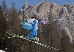 Slovenia's Tina Maze speeds down the course during an alpine ski, women's World Cup downhill, in Cortina D'Ampezzo, Italy, Saturday, Jan. 25, 2014. Maze placed first. (AP Photo/Domenico Stinellis)