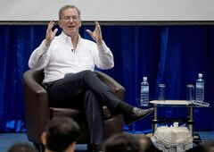 Google Executive Chairman Eric Schmidt gestures during an interactive session with group of students at a technical university in Yangon, Myanmar, Friday, March 22, 2013. Schmidt on Friday urged Myanmar's government to allow private businesses to develop the country's woeful telecommunications infrastructure, emphasizing the importance of competition and free speech. (AP Photo/Gemunu Amarasinghe)