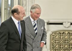 Britain's Prince Charles, right, walks next to Romania's President Traian Basescu, left, at the Cotroceni Presidential Palace in Bucharest, Romania. Monday, June 3, 2013.(AP Photo/Vadim Ghirda)