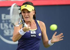 Agnieszka Radwanska, of Poland, returns to Ekaterina Makarova, of Russia, during semifinal play at the Rogers Cup tennis tournament Saturday August 9, 2014 in Montreal. THE CANADIAN PRESS/Paul Chiasson