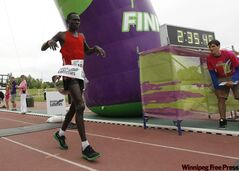Philip Samoei said he wasn't happy with his time after winning the 2011 Manitoba Marathon. Although he said he ran 'more than two kilometres' extra, he still managed to win by more than eight minutes.