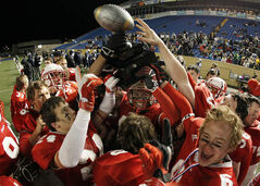 Kelvin Clippers celebrate a win over the Grant Park Pirates High School Football at the Free Press Bowl at Canad Inn Stadium, November 9, 2012.
