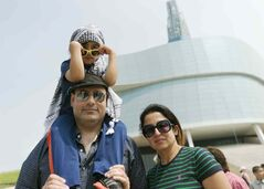 Hussam Azzam, his wife Orhan Khalil-Azzam and their son A.K. Azzam attend the rally for Gaza on Saturday.