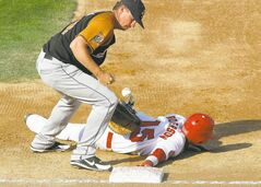 Winnipeg's Chris Roberson gets back to the bag in front of Sioux Falls Pheasants' first baseman Trevor Lawhorn Saturday at Shaw Park. While the Fish belted out 14 hits, the Pheasants put up 15 runs.