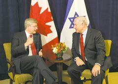 Stephen Harper and Benjamin Netanyahu discuss the threat of a nuclear-armed Iran in New York on Friday.