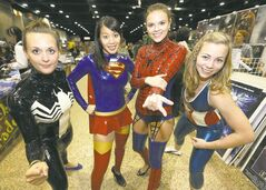 From left, Kassandra Momotiuk (Venom), Kelly Chin (Supergirl), Courtney Bannatyne (Spider Girl), and Marill Barratt (Captain America) from the Mayhem Cheerleading Team, at the Central Canada Comic Con Saturday.