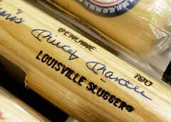 A Roger Maris and Mickey Mantle co-signed baseball bat were among the collectibles displayed at the Bergen County Prosecutors Office in Hackensack, N.J., on Wednesday, Nov. 14,2007. The items were seized from the Vermont home of  William Stracher who is being charged with making millions of dollars from selling stolen samples of prescription drugs. Authorities want the assests forfeited because they allege the 65-year-old bought the items to launder money.(AP Photo/The Record/Jim Anness)