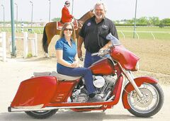 Georgette Jhass, the founder of the Breast Cancer Pledge Ride, with Dan Roche, owner of NC Machine and a longtime supporter of the cause. The ride departs from Assiniboia Downs Sunday morning.
