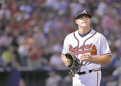 Atlanta Braves starting pitcher Kris Medlen leaves in the fifth inning against the Los Angeles Dodgers in Game 1 of the National League Division Series in Atlanta, Georgia, on Thursday, October 3, 2013. The Dodgers won, 6-1.