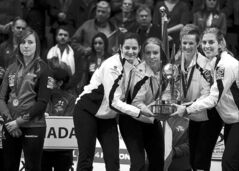 Canada skip Rachel Homan (left) looks on as Switzerland's Binia Feltscher, Irene Schori, Franziska Kaufmann and Christine Urech collect the spoils.